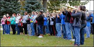 The Port Clinton High School marching band performs at a pep rally for  Devin Kohlman at Waterworks Park.