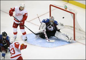 Colorado Avalanche goalie Semyon Varlamov lets in a goal by Red Wings' Johan Franzen in a  game on Oct. 17 in Denver.