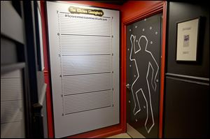 The men's bathroom door is part of the police and crime theme  used throughout The Kitchen Consigliere in Collingswood, N., owned by convicted mobster  Angelo Lutz.