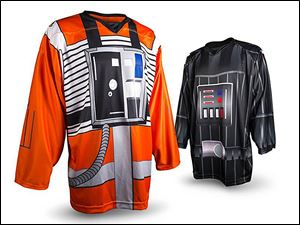 The Walleye will wear X-Wing Pilot-themed jerseys, left, and the Kalamazoo Wings will wear Darth Vader-themed jerseys on Saturday.