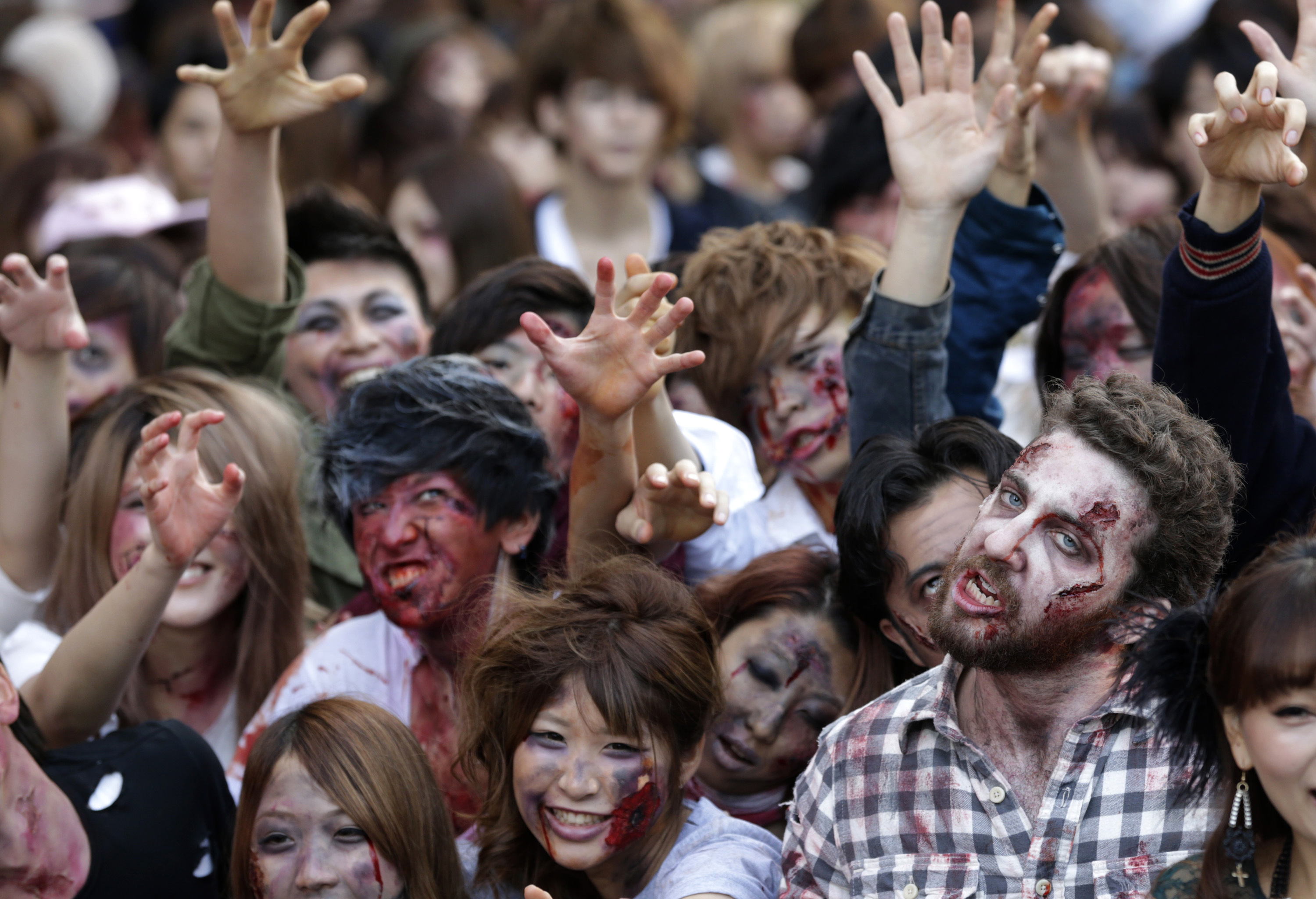 zombies swarm tokyo tower in halloween stunt the blade