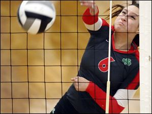 Central Catholic's Meghan Koralewski (6) spikes the ball against Celina during a D-II regional semifinal volleyball game Thursday.