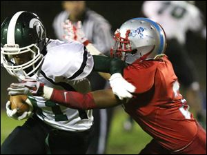 Start's ball carrier Tremain Batson attempts to evade Bowsher's Lamar Smith.