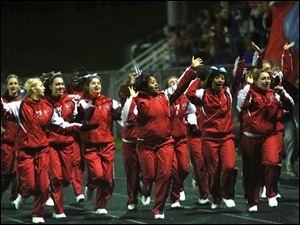 Bowsher's cheerleaders lead the crowd in cheering.