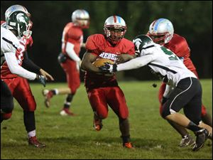 Bowsher's ball carrier Khane Collins, center, dodges Start defenders.