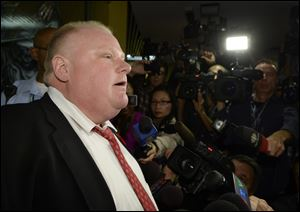 Mayor Rob Ford talks to media at City Hall in Toronto on Thursday.