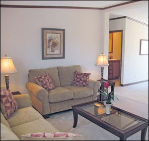 The living room is open to the dining area and kitchen. It's ideal for entertaining guests.