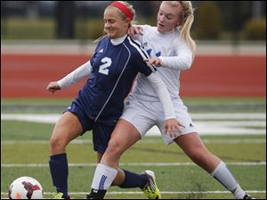 Anthony Wayne's Jessie Mattimoe (11) battles Rocky River Magnificat's Sarah Lawrence (2) for the ball.