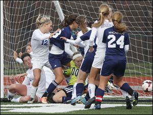 Anthony Wayne's Sam Smith (20) scores a goal against  Rocky River Magnificat.