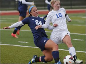 Anthony Wayne's Susan Nutter (16) battles Rocky River Magnificat's Erin King (24) for the ball.