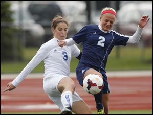 Anthony Wayne's Abby Allen (3) and Rocky River Magnificat's Sarah Lawrence (2) battle for the ball.