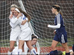 Anthony Wayne's Sam Smith (20) celebrates scoring a goal with Katelyn bixler (12) against  Rocky River Magnificat.