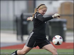 Anthony Wayne's goalie Taylor Hill (1) kicks the ball against Rocky River Magnificat.