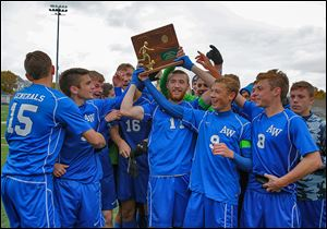Anthony Wayne celebrates its Division I regional soccer championship. The Generals are 17-0-4.