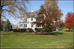 The historic farm house is the centerpiece of the Castalia Farms property.