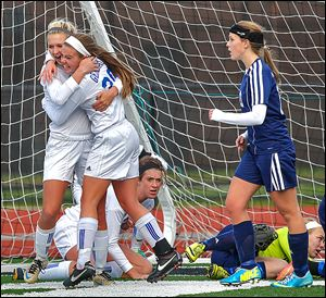 Anthony Wayne's Sam Smith celebrates with Katelyn Bixler, left, after Smith's goal in the regional final.