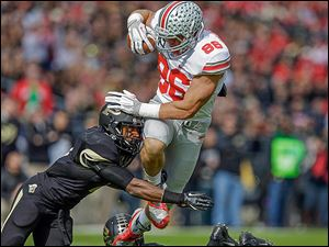 Ohio State tight end Jeff Heuerman, right, is hit by Purdue defensive back Anthony Brown on Saturday in West Lafayette, Ind. Heuerman caught a 40-yard touchdown pass in the first half.