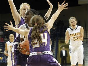 UT's Janice Monakana plows through Ashland's Suzy Wollenhaupt, left, and Taylor Woods.