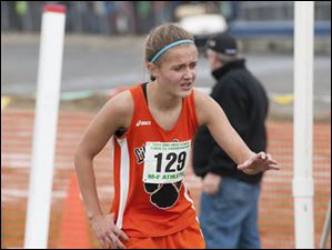 Brittany Atkinson (129) of Liberty Center grimaces after finishing the race.