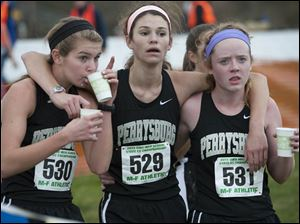 Perrysburg runners Jordan Doore (530), Courtney Clody (529) and Emily Henry (531) are shown after finishing the race.