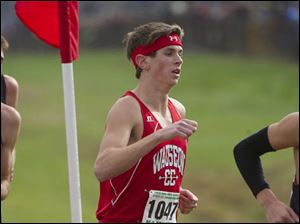Quintin Reiser of Wauseon runs near the mid-point of the race.