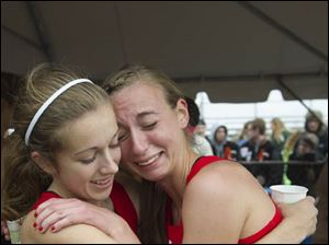 Taylor Vernot, left, gets a hug from teammate Megan Beck after winning the Ohio High School Girls Div. II cross country championsips.