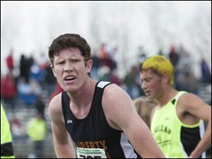 Cameron Weeks of Liberty Center reacts after finishing the race.