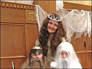 Christopher, Audrey & Knickolas Laux went as Gimli, Arwen & Saruman from Lord of the Rings