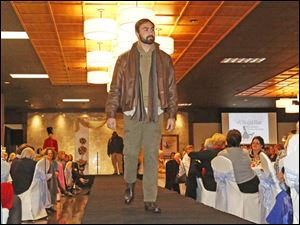 Michael Barlos hits the catwalk during this year's Ability Center Fashion Show