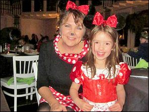 Jennifer Douglas, Membership Director at TCC and Ava Grace Disalle.  Both Minnie Mouse for a night!