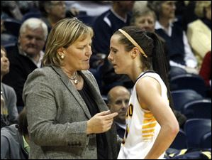 UT coach Tricia Cullop talks with Stephanie Recker during a their game.