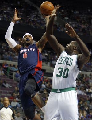 Detroit Pistons forward Josh Smith takes a shot against Boston Celtics forward Brandon Bass during the second half Sunday in Auburn Hills, Mich. Smith scored 15 points and pulled down seven rebounds in a 87-77 win.