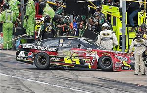 Jeff Gordon heads to the garage after he brushed the wall at Texas Motor Speedway in Fort Worth. Gordon came into the day third in the points standings but left in sixth place.