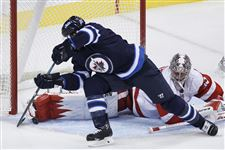 Winnipeg-Jets-Matt-Halishchuk-15-is-stop