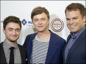 Daniel Radcliffe, Dane DeHaan, and Michael C. Hall arrive at the premiere of 'Kill Your Darlings' Oct. 3 at the Writers Guild Theater in Beverly Hills, Calif.