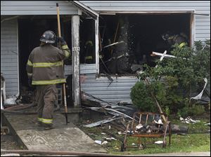 A deadly fire in East Toledo apparently began on the first floor in a living room hallway on Saturday.