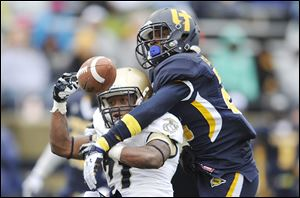 Toledo freshman DeJuan Rogers, right, breaks up a pass intended for Navy's DeBrandon Sanders earlier this season.