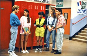 From left, Mark-Paul Gosselaar as Zack Morris, Tiffani Thiessen as Kelly Kapowski, Lark Voorhies as Lisa Turtle, Elizabeth Berkley as Jessie Spanoright, and Mario Lopez  as A.C. Slater, star in 'Saved by the Bell.'