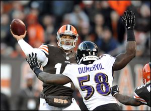 Browns quarterback Jason Campbell fires a touchdown pass over the Ravens' Elvis Dumervil. He had three touchdown passes.