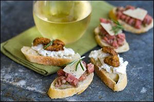 Crostini topped with goat cheese and candied nuts or steak tartare.