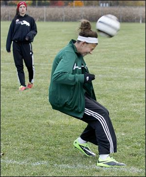 Emma Barney, a freshman, heads the ball during practice. Barney has 30 goals and 20 assists.