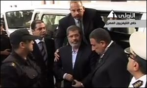 Ousted President Mohammed Morsi arrives for a court hearing at a police academy compound in Cairo, Egypt, today, on Egyptian State Television.