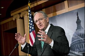 Sen. Tom Harkin, D-Iowa, chairman of the Health, Education, Labor, and Pensions Committee, talks to reporters after the Senate cleared a major hurdle and agreed to proceed to debate a bill that would prohibit workplace discrimination against gay, bisexual and transgender Americans today at the Capitol in Washington.