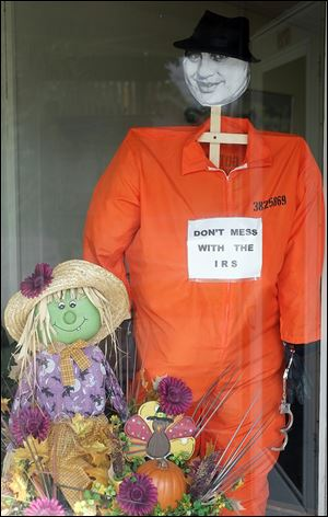 An Al Capone scarecrow decorates the window of Spring Valley Business Solutions in Whitehouse.
