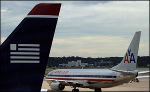 Attorney General Eric Holder said today that American Airlines and US Airways must make broad concessions if they want to settle a lawsuit blocking their proposed merger.