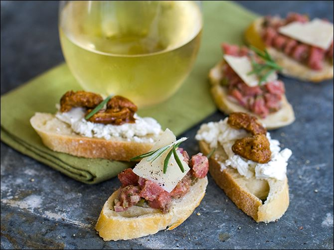 Thanksgiving No Cook Sides Crostini topped with goat cheese and candied nuts or steak tartare.