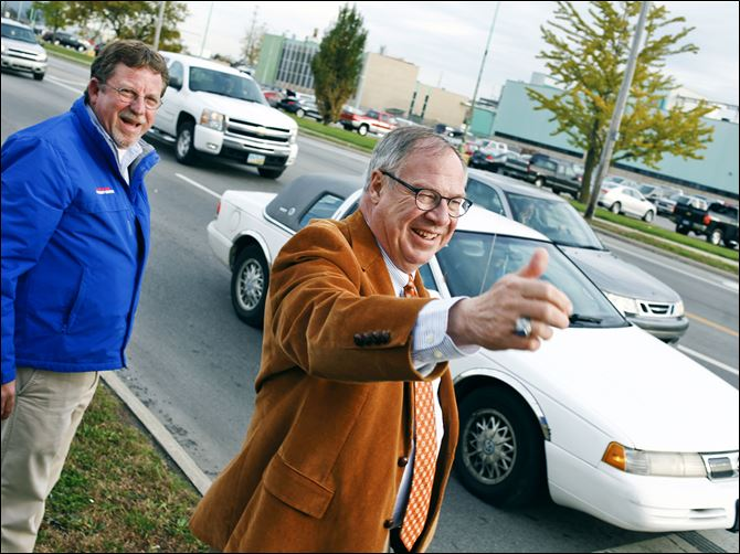 5n3votecollins-2 D. Michael Collins greets motorists in front of General Motors Co.'s Toledo Transmission  plant on West Alexis Road during final voter outreach Monday.
