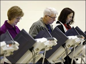 Terrie Weiss, from left, Jim Weiss, and Laurie Flowers vote.