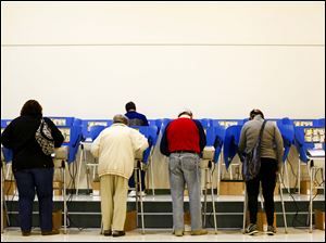 People cast their ballots, Tuesday, at the Rossford Board of Education Bulldog Hall in Rossford.