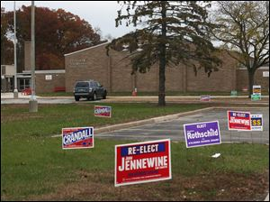 Political signs dotted the drive up to McCord Junior High School's polling location in Sylvania.